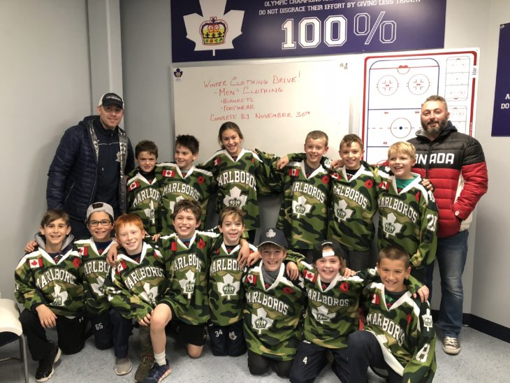 Minor Atom Toronto Marlboros in camo jerseys to honour Remembrance Day.